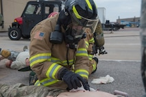 U.S. Air Force Senior Airman Dylan Rousseau, a fire protection member assigned to the 97th Civil Engineer Squadron, performs Emergency Medical Technician (EMT) procedures on a victim of a simulated chemical attack