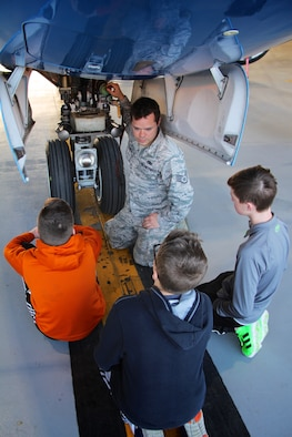 Staff Sgt. David Schallenberg helps the 932nd Airlift Wing welcome eighth grade Science, Technology, Engineering, and Mathematics (STEM) students for a visit December 10, 2018, at Scott Air Force Base, Illinois. Schallenberg, a C-40 aircraft maintainer from the 932nd Maintenance Group, speaks to local Mascoutah students about how an airplane engine, wheels, tires, hydraulics and wings work to get a plane off the ground. He manned this informational station as multiple groups of students rotated through his area every 45 minutes at the reserve unit in southern Illinois near Belleville.  (U.S. Air Force photo by Lt. Col. Stan Paregien)