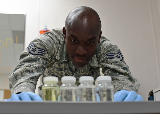 U.S. Air Force Staff Sgt. Kwadwo Dankyi, 325th Aerospace Medicine Squadron bioenvironmental engineering technician, examines water samples while at Tyndall Air Force Base, Fla., Dec. 8, 2018. Dankyi returned in the wake of Hurricane Michael to a ravaged installation and was eager to begin helping in the rebuilding process. (U.S. Air Force photo by Senior Airman Isaiah J. Soliz)