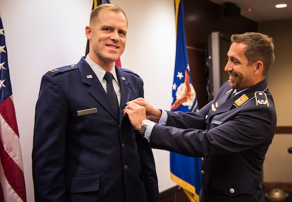 An advanced weapons technology Airman here received the German Cross of Honor bronze medal Nov. 30.