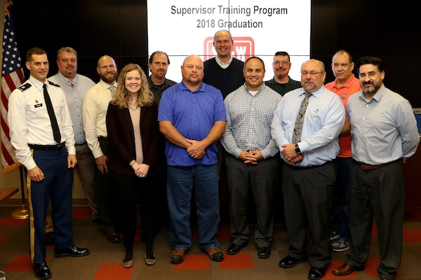 Maj. Justin Toole, U.S. Army Corps of Engineers Nashville District deputy commander, joins the 13 graduates of the 2018 Supervisory Training Program class for the last session and graduation ceremony Dec. 4, 2018 at the Nashville District Headquarters in Nashville, Tenn. (USACE photo by Mark Abernathy)