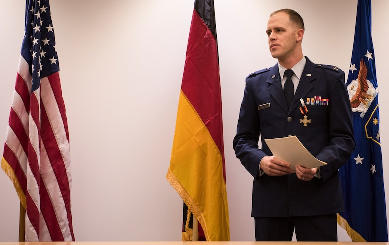 An advanced weapons technology Airman here received the German Cross of Honor, bronze medal Nov. 30.