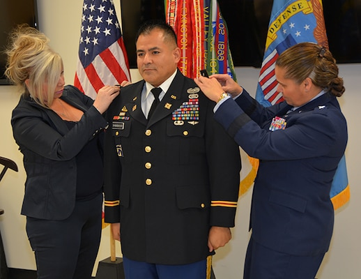 DLA Aviation commander and wife pin Lt. Col Shimaburkuro with new ranl
