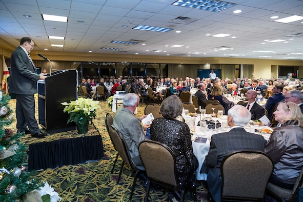 Multiple people attending a banquet.