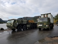U.S. Marines with II Marine Expeditionary Force, maneuver vehicles after off-load equipment for NATO exercise Trident Juncture from American Roll-on Roll-off Carrier Resolve in Hammernesodden, Norway, Sept. 24, 2018. Marines and service members from the Norwegian Armed Services unloaded nearly 200 military vehicles and more than 70 containers with military equipment in two days despite cold weather with periods of rain and sleet. (Photo by Kyle Soard)