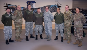 Medical health officers from the Chilean Air Force pose for a photo with members from the 59th Medical Wing's Critical Care Air Transport Team on Dec.7, at Camp Bramble on Joint Base San Antonio-Lackland, Texas. The Chileans toured Wilford Hall's Simulation Center, which provides a hands-on learning environment through the use of high-fidelity mannequins and virtual reality simulators, before visiting Camp Bramble, the CCATT training and mission staging location. (U.S. Air Force photo by Kiley Dougherty)