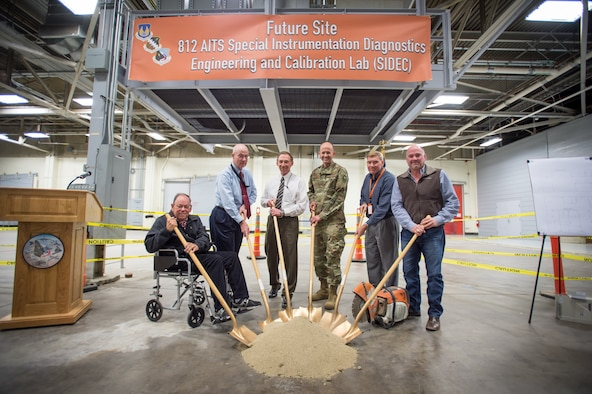 Edwards and 812th Aircraft Instrumentation Test Squadron leadership pose for the ceremonial ground breaking photo Dec. 3 inside Bldg. 1600 where a new 812th AITS Special Instrumentation Diagnostics Engineering and Calibration Lab will be constructed. Pictured from left to right: Randy Beckett, 412th Civil Engineer Group retired deputy base civil engineer; James Judkins, 412th CEG director and base civil engineer; Richard Backs, 412th Test Wing Plans and Programs; Brig. Gen. E. John Teichert, 412th TW commander; Alan Colthorp, 812th AITS director; and John Bennett, Modular Management Group chief operations officer. (U.S. Air Force photo by Kyle Larson)