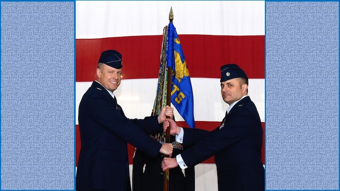 Lt. Col. Vincent Danna, right, accepts the 96th Flying Training Squadron guidon from Col. Allen Duckworth, 340th Flying Training Group commander, during an assumption-of-command ceremony held Dec. 6 at Laughlin Air Force Base, Texas. (U.S. Air Force photo by Airman 1st Class Anne McCready)