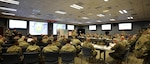 """U.S. Army Maj. Gen. Bill Hall, JTF-CS commander speaks to senior leaders and representatives at the Mission Planning Conference (MPC), Fort Eustis, Va., Dec. 3-4, 2018. The MPC prepared and strengthened communication roles of the Defense Chemical, Biological, Radiological and Nuclear (CBRN) Response Force (DCRF) and other DoD CBRN Response Enterprise (CRE) entities for participation in response operations. In the event of a catastrophic CBRN incident, the JTF-CS and DCRF missions assist local, state, federal and tribal partners in saving lives, preventing further injury, and providing critical support to enable community recovery when conducting Defense Support of Civil Authorities (DSCA) response operations.   """"This is also a good stage setter for Exercise Sudden Response/Determined Response in January 2019 because we addressed important issues and solutions, leading to an action plan for success,"""" said Hall. (DoD photo by U.S. Air Force Tech. Sgt. Michael Campbell/ Released)"""