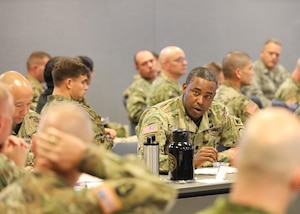 U.S. Army Lt. Col. Maurice Green, deputy commander of the 16th Military Police Brigade, Fort Bragg, N.C., speaks to the panel of JTF-CS Mission Planning Conference (MPC) at Fort Eustis, Va., Dec 4, 2018. Senior leaders and representatives from 26 units across the United States and Canada attended the two-day conference. The MPC prepared and strengthened communication roles of the Defense Chemical, Biological, Radiological and Nuclear (CBRN) Response Force (DCRF) and other DoD CBRN Response Enterprise (CRE) entities for participation in response operations. In the event of a catastrophic CBRN incident, the JTF-CS and DCRF missions assist local, state, federal and tribal partners in saving lives, preventing further injury, and providing critical support to enable community recovery when conducting Defense Support of Civil Authorities response operations. (DoD photo by U.S. Air Force Tech. Sgt. Michael Campbell/ Released)