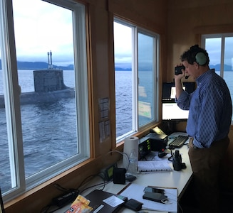 Bill Fagan, a trial director at Naval Surface Warfare Center, Carderock Division, measures the distance to the Virginia-class fast-attack submarine USS Texas (SSN 775) as they prepare to submerge the boat for an exercise on Oct. 26, 2018, in Carderock's Southeast Alaska Acoustic Measurement Facility (SEAFAC) static site off the coast of Ketchikan, Alaska. (U.S. Navy photo by Kelley Stirling/Released)