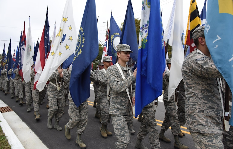 Airmen from the 81st Training Group carry the 50 state flags in the Ocean Springs Christmas Parade in Ocean Springs, Mississippi, Dec. 9, 2018. The Keesler Honor Guard also participated in the event. (U.S. Air Force photo by Kemberly Groue)