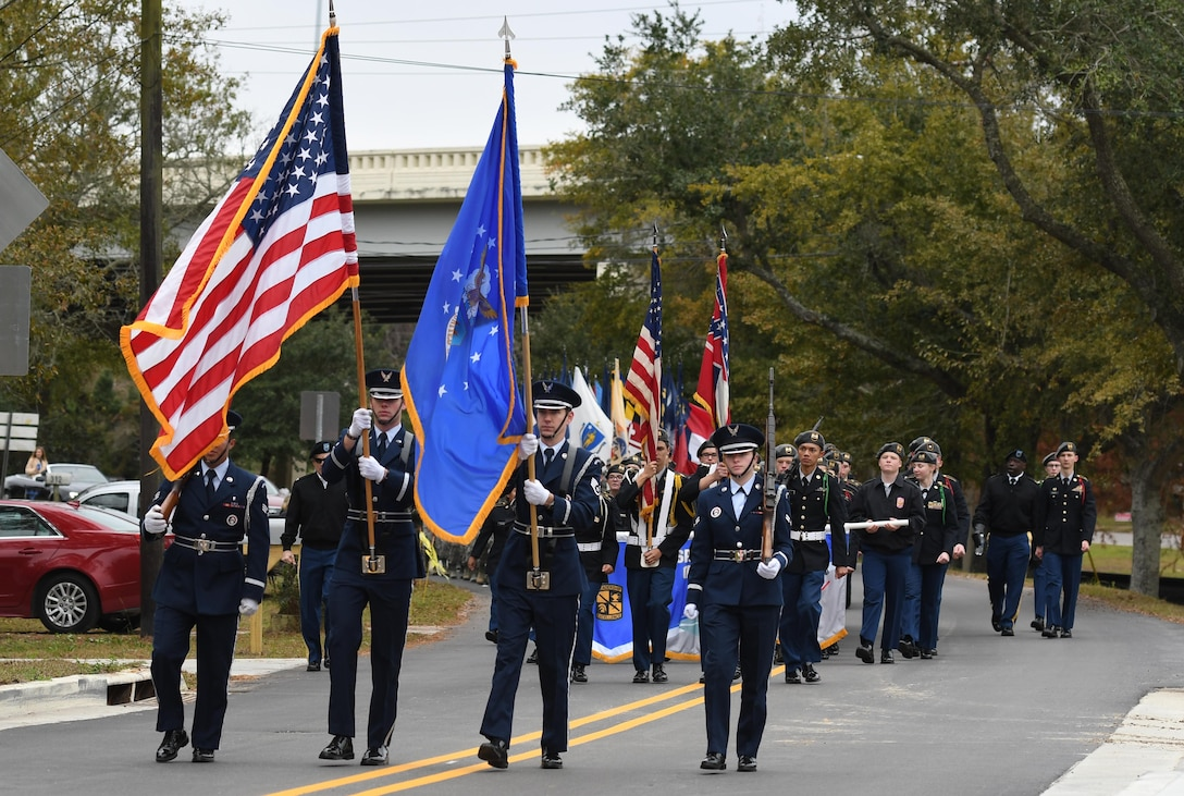 The Keesler Honor Guard marches in the Ocean Springs Christmas Parade in Ocean Springs, Mississippi, Dec. 9, 2018. Airmen from the 81st Training Group also participated in the event. (U.S. Air Force photo by Kemberly Groue)