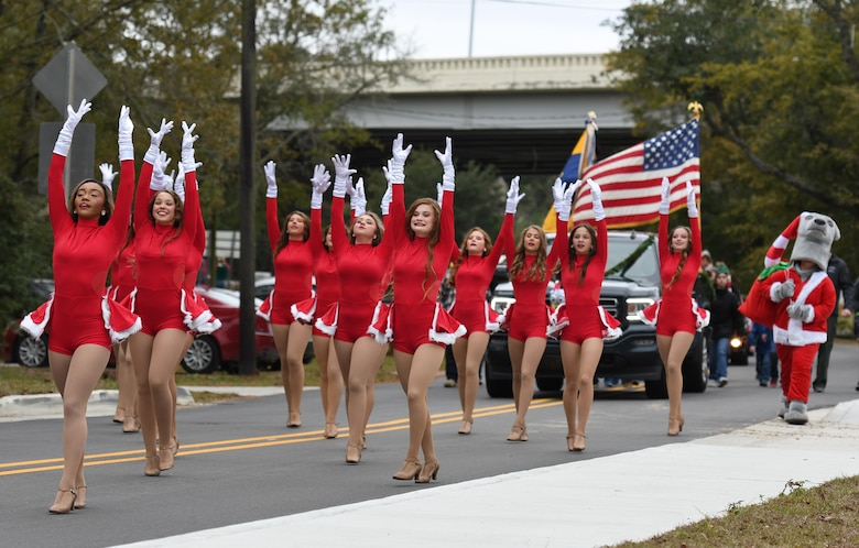 The Ocean Springs High School dance team performs in the Ocean Springs Christmas Parade in Ocean Springs, Mississippi, Dec. 9, 2018. The Keesler Air Force Base Honor Guard and 81st Training Group Airmen participated in the event. (U.S. Air Force photo by Kemberly Groue)