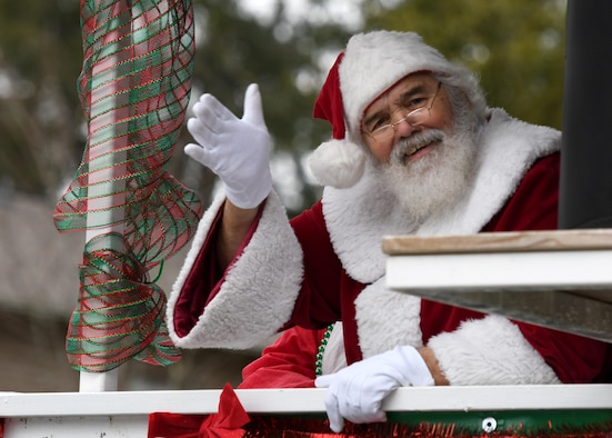 Santa Claus waves to attendees during the Ocean Springs Christmas Parade in Ocean Springs, Mississippi, Dec. 9, 2018. The Keesler Air Force Base Honor Guard and 81st Training Group Airmen participated in the event. (U.S. Air Force photo by Kemberly Groue)