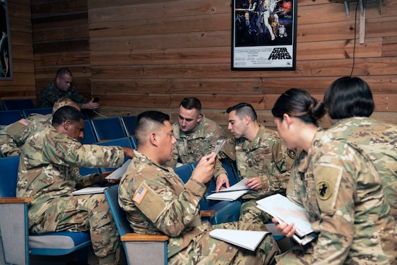 Joint Task Force-Bravo (JTF-Bravo) service members discuss a class activity during a Joint Humanitarian Operations Course at Soto Cano Air Base (SCAB), Honduras, Dec. 3, 2018.