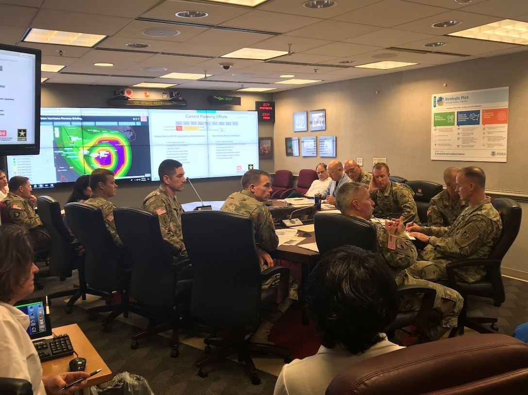 Lt. Gen. Todd T. Semonite, U.S. Army Chief of Engineers and Commanding General of the U.S. Army Corps of Engineers, and senior leaders closely monitor Hurricane Florence in Washington D.C., September 2018. On the left screen is the South Atlantic Division viewer produced by the GIS team supporting Hurricane Florence Response.