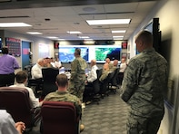 Lt. Gen. Todd T. Semonite, U.S. Army Chief of Engineers and Commanding General of the U.S. Army Corps of Engineers, and senior leaders closely monitor Hurricane Florence in Washington D.C., September 2018. On the left screen is the South Atlantic Division viewer produced by the GIS team supporting Hurricane Florence Response. (Submitted photo)