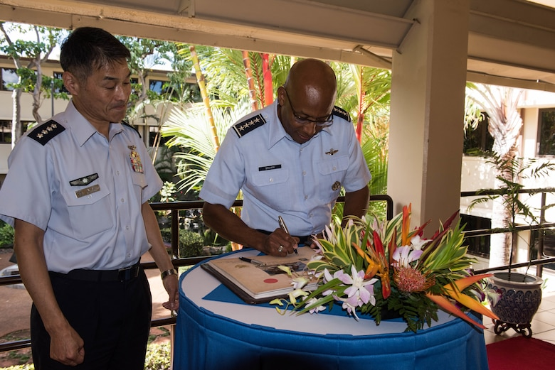 Gen. Yoshinari Marumo, Japanese Air Self-Defense Force chief of staff, and Gen. CQ Brown, Jr., Pacific Air Forces commander, sign a guest book during Marumo's visit to Headquarters Pacific Air Forces on Joint Base Pearl Harbor-Hickam, Hawaii, Dec. 4, 2018. As part of his trip, Marumo met with PACAF leadership to discuss the PACAF strategy and future engagements. The U.S. and Japan routinely work together to promote security cooperation and support a free and open Indo-Pacific region. (U.S. Air Force photo/Staff Sgt. Hailey Haux)