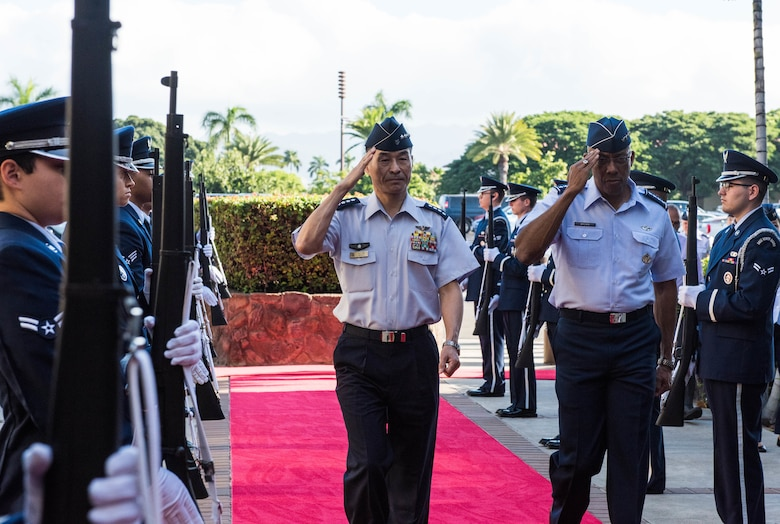 Gen. CQ Brown, Jr., Pacific Air Forces commander, hosted Gen. Yoshinari Marumo, Japanese Air Self-Defense Force chief of staff, salute the honor cordon at Headquarters PACAF on Joint Base Pearl Harbor-Hickam, Hawaii, Dec. 4, 2018. As part of his trip, Marumo met with PACAF leadership to discuss the PACAF strategy and future engagements. The U.S. and Japan routinely work together to promote security cooperation and support a free and open Indo-Pacific region. (U.S. Air Force photo/Staff Sgt. Hailey Haux)