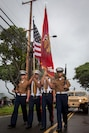 U.S. Marines with the Marine Aircraft Group 24 colorguard march during the 2018 Waimanalo Christmas Parade, Dec. 8, 2018. The parade is held annually and supported by U.S. Marines from Marine Corps Base Hawaii. (U.S. Marine Corps photo by Cpl. Matthew Kirk)