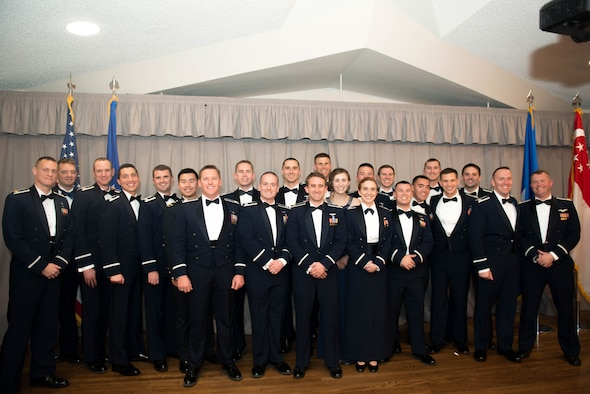 United States Air Force Test Pilot School Class 18A stood proudly before friends, families, base leadership and fellow testers at Club Muroc as they received their Master of Science Degree in Flight Test Engineering Dec. 7. (U.S. Air Force photo by Joe Jones)