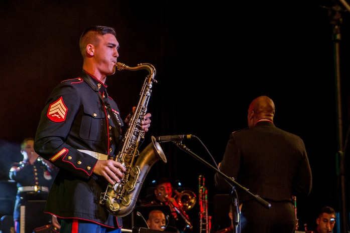 Sgt. Spencer Day, a musician with the Marine Forces Reserve Band, plays the saxophone during the annual holiday concert at Saenger Theatre in New Orleans, Dec. 9, 2018. The performance is one of several holiday concerts the band arranged throughout December to promote the Marine Corps Reserve Toys for Tots program, which donates toys to less fortunate children in the community. (U.S. Marine Corps photo by Lance Cpl. Samantha Schwoch)