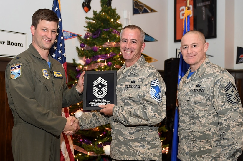 Col. Clint ZumBrunnen, 437th Airlift Wing commander, left, and Chief Master Sgt. Ronnie Phillips, 437th AW command chief, right, congratulate chief select, Senior Master Sgt. Michael Murray, 437th Aircraft Maintenance Squadron flight superintendent, during a release party held Dec. 7, 2018, at Joint Base Charleston, S.C. A release party was held in their honor at the Charleston Club, where base members gathered in support and celebration.