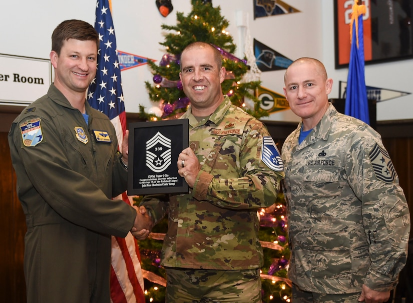Col. Clint ZumBrunnen, 437th Airlift Wing commander, left, and Chief Master Sgt. Ronnie Phillips, 437th AW command chief, right, congratulate chief select, Senior Master Sgt. Trapper Otto, 437th Maintenance Squadron flight superintendent, during a release party held Dec. 7, 2018 at Joint Base Charleston, S.C. Chief master sergeant is the highest enlisted rank in the Air Force and is held by one percent of the enlisted force.