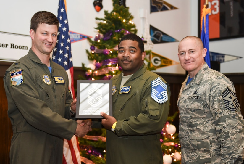 Col. Clint ZumBrunnen, 437th Airlift Wing commander, left, and Chief Master Sgt. Ronnie Phillips, 437th AW command chief, right, congratulate chief select, Senior Master Sgt. Lacario Tufts, 14th Airlift Squadron flight superintendent, during a release party held Dec. 7, 2018, Joint Base Charleston, S.C. A release party was held in their honor at the Charleston Club, where base members gathered in support and celebration.