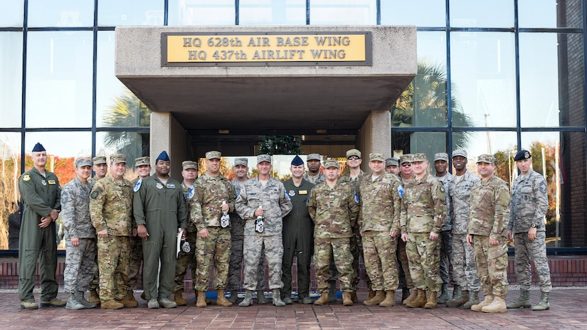 Joint Base Charleston Chief's group members and the newest chief master sergeant selects stand together outside the headquarters building Dec. 4, 2018, at JB Charleston, S.C.  Chief master sergeant is the highest enlisted rank in the Air Force and is held by only one percent of the enlisted force.