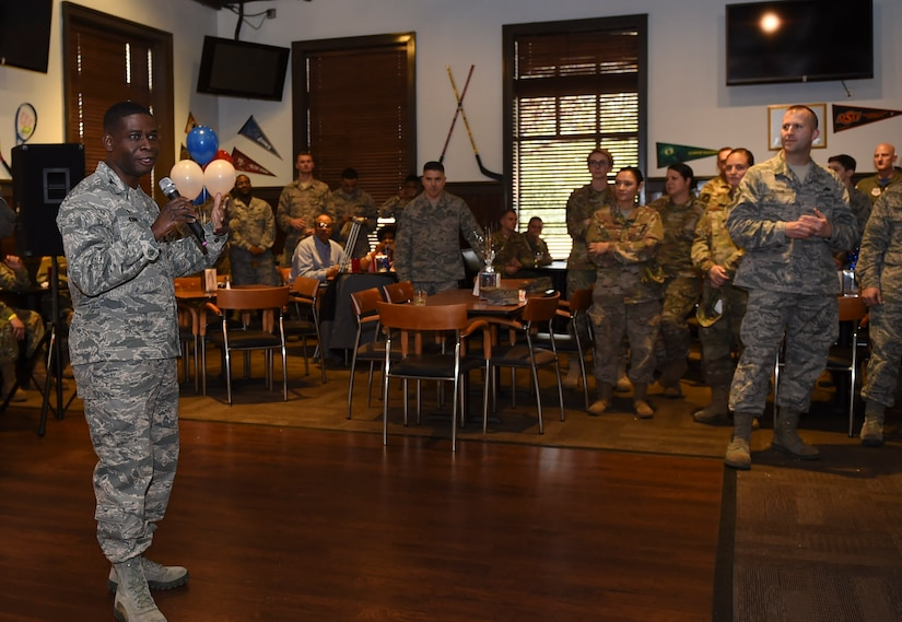 Col. Terrence Adams, 628th Air Base Wing and Joint Base Charleston commander, congratulates newest chief selects during a release party held Dec. 7, 2018, at JB Charleston, S.C. A release party was held in their honor at the Charleston Club, where base members gathered in support and celebration.