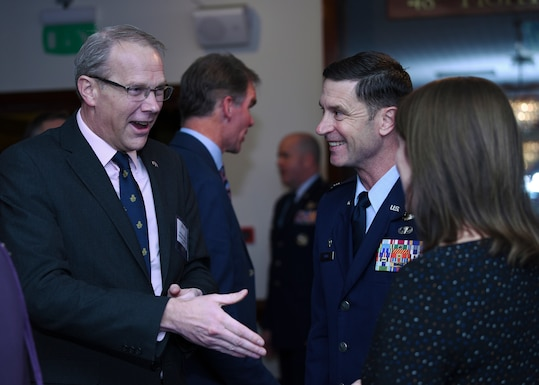 U.S. Air Force Col. Matthew Smith, 352nd Special Operations Wing commander, greets distinguished visitors at the Yuletide reception at Royal Air Force Lakenheath, England, Dec. 7, 2018. Events like this provide unmatched opportunities for senior U.S. military members and UK community leaders to further build trust and comradery. (U.S. Air Force photo by Airman 1st Class Madeline Herzog)