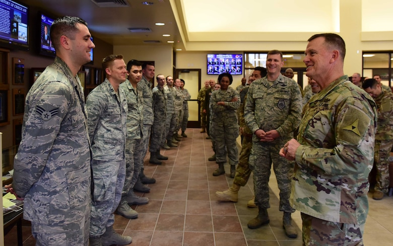 U.S. Army Lt. Gen. Paul Funk, III Armored Corps and Fort Hood, Texas, commanding general recognizes Creech Airmen for exemplary job performance at Creech Air Force Base, Nevada, Dec. 10, 2018. This visit was an opportunity for Funk to meet with the Remotely Piloted Aircraft Airmen who fly, maintain and support the MQ-9 Reaper that has been providing airstrike capabilities for his ground troops since the start of Operation Inherent Resolve in June 2014. (U.S. Air Force Photo by Airman 1st Class Haley Stevens)