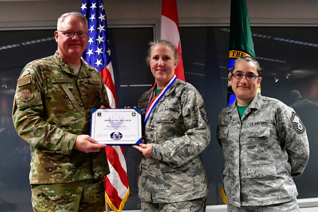 Master Sgt. Malinda Gonnuscio, 225th Air Defense Group training manager is named the 225th ADG SNCO of the Year Dec. 1, 2018 on Joint Base Lewis-McChord.  Gonnuscio poses with Col. William Krueger (left), 225th ADG commander and Senior Master Sgt. Rebekah St. Romain, 225th ADG superintendent.  (U.S. Air National Guard photo by Maj. Kimberly D. Burke)