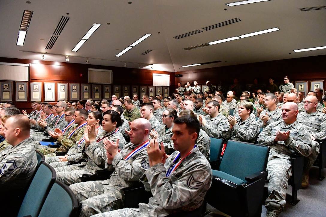 Members of the Western Air Defense Sector clap during the 2018 WADS annual awards ceremony Dec. 1, 2018 on Joint Base Lewis-McChord, Washington.