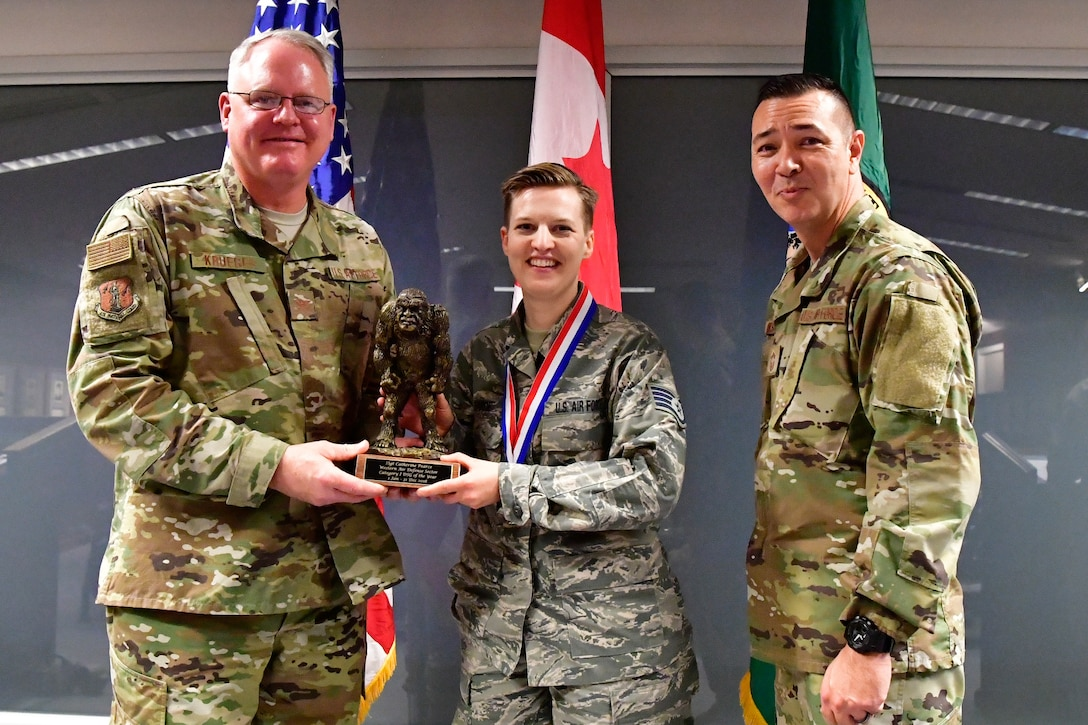 Staff Sgt. Catherine Pearce, 225th Support Squadron emergency management specialist, is named the Western Air Defense Sector Category I Drill Status Guardsmen of the Year Dec. 1, 2018 on Joint Base Lewis-McChord.  Pearce poses with Col. William Krueger (left), 225th Air Defense Group commander and Chief Master Sgt. Allan Lawson, WADS senior enlisted leader .  (U.S. Air National Guard photo by Maj. Kimberly D. Burke)