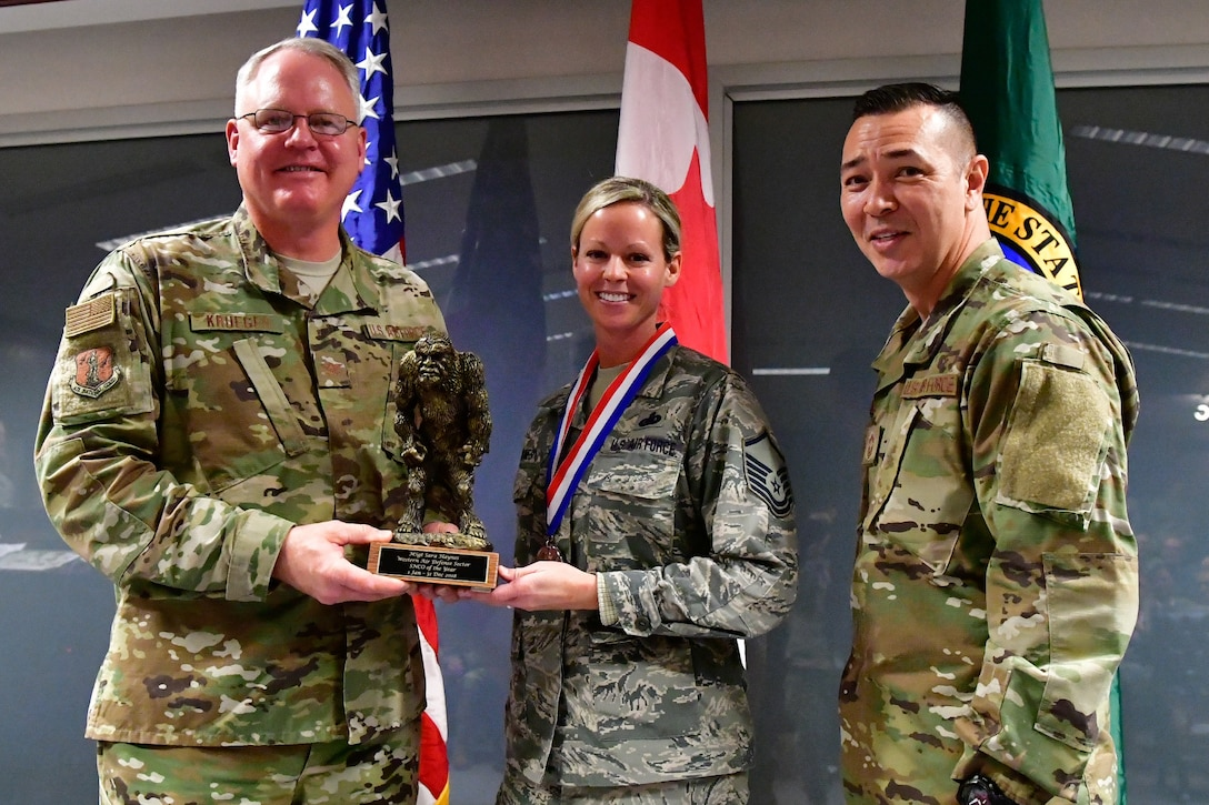 Master. Sgt. Sara Haynes, 225th Support Squadron NCOIC of logistics is named the Western Air Defense Sector SNCO of the Year Dec. 1, 2018 on Joint Base Lewis-McChord. Haynes poses with Col. William Krueger (left), 225th Air Defense Group commander and Chief Master Sgt. Allan Lawson, WADS senior enlisted leader .  (U.S. Air National Guard photo by Maj. Kimberly D. Burke)