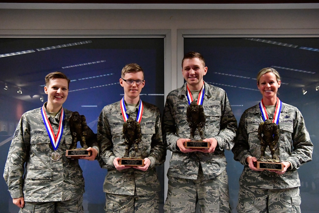 The Western Air Defense Sector annual award winners pose with their Bigfoot trophy Dec. 1, 2018 on Joint Base Lewis-McChord, Washington. Pictured from left to right are Category I Drill Status Guardsmen of the Year Staff Sgt. Catherine Pearce, 225th Support Squadron emergency management specialist; Airman of the Year Senior Airman Zachary Fleet, 225th Air Defense Squadron interface control technician; NCO of the Year Staff Sgt. Jared Denton, 225th ADS NCOIC of surveillance training; and SNCO of the Year Master Sgt. Sara Haynes, 225th SS NCOIC of logistics.  Not pictured are: DSG Company Grade Officer Capt. Colette Muller, 225th Air Defense Group public affairs officer; CGO of the Year Capt. Marvin Yamada, 225th ADS weapons flight commander; Category I Civilian of the Year Barry Arzberger, 225th SS HVAC technician; and Category II Civilian of the Year Bruce Robie; 225th SS National Airspace System Defense program manager.  (U.S. Air National Guard photo by Maj. Kimberly D. Burke)