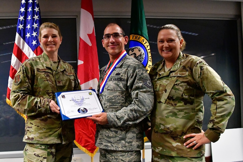 Tech. Sgt. Edwin Aviles, 225th Support Squadron cyber infrastructure technician is named the 225th Support Squadron NCO of the Year Dec. 1, 2018 on Joint Base Lewis-McChord.  Aviles poses with Col. Paige Abbott (left), 225th SS commander and Chief Master Sgt. Laurie Doyle, 225th SS chief enlisted manager. (U.S. Air National Guard photo by Maj. Kimberly D. Burke)