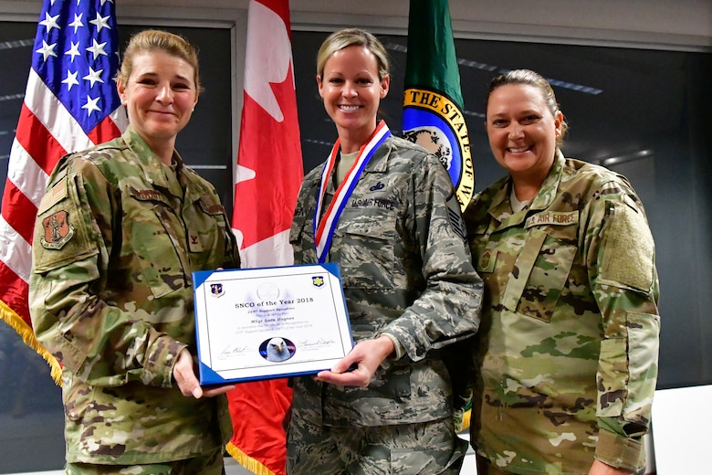 Master. Sgt. Sara Haynes, 225th Support Squadron NCOIC of logistics is named the 225th Support Squadron SNCO of the Year Dec. 1, 2018 on Joint Base Lewis-McChord.  Haynes poses with Col. Paige Abbott (left), 225th SS commander and Chief Master Sgt. Laurie Doyle, 225th SS chief enlisted manager. (U.S. Air National Guard photo by Maj. Kimberly D. Burke)
