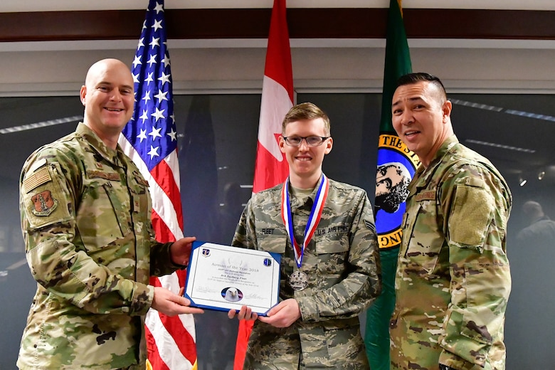 Senior Airman Zachary Fleet, 225th Air Defense Squadron interface control technician is named the 225th ADS Airman of the Year Dec. 1, 2018 on Joint Base Lewis-McChord.  Fleet poses with Col. Brett Bosselmann (left), 225th ADS commander and Chief Master Sgt. Allan Lawson, 225th ADS chief enlisted manager. (U.S. Air National Guard photo by Maj. Kimberly D. Burke)