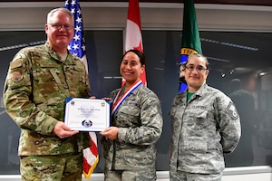 Tech. Sgt. Jocelyn Somol, 225th Air Defense Group human resource specialist is named the 225th ADG NCO of the Year Dec. 1, 2018 on Joint Base Lewis-McChord.  Somol poses with Col. William Krueger (left), 225th ADG commander and Senior Master Sgt. Rebekah St. Romain, 225th ADG superintendent.  (U.S. Air National Guard photo by Maj. Kimberly D. Burke)