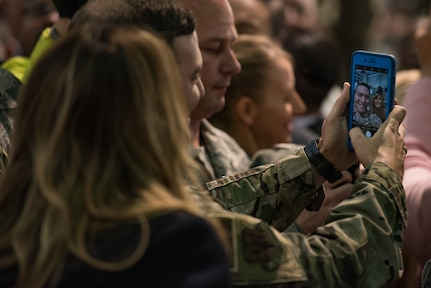 First Lady Melania Trump takes a selfie with a U.S. Air Force Airman at Joint Base Langley-Eustis, Virginia, Dec. 12, 2018.
