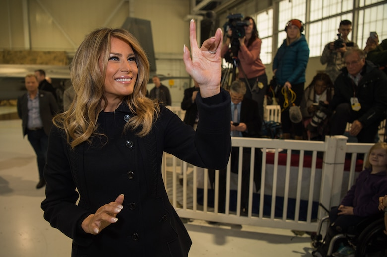 First Lady Melania Trump waves to children at Joint Base Langley-Eustis, Virginia, Dec. 12, 2018.