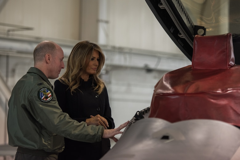 U.S. Air Force Col. Jason Hinds, 1st Fighter Wing commander, gives a tour of the F-22 Raptor to First Lady Melania Trump at Joint Base Langley-Eustis, Virginia, Dec. 12, 2018.