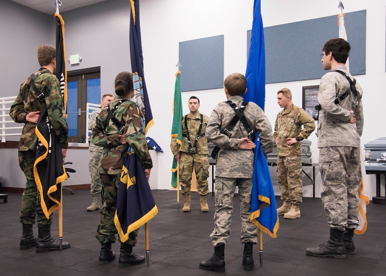 Team Fairchild Honor Guardsmen help four Civil Air Patrol Spokane Composite Squadron cadets train with flags at Fairchild Air Force Base, Washington, Nov. 26, 2018. CAP is a volunteer organization that performs three congressionally assigned key missions: emergency services, disaster relief operations and aerospace education for youth and the general public. (U.S. Air Force photo by Senior Airman Ryan Lackey)