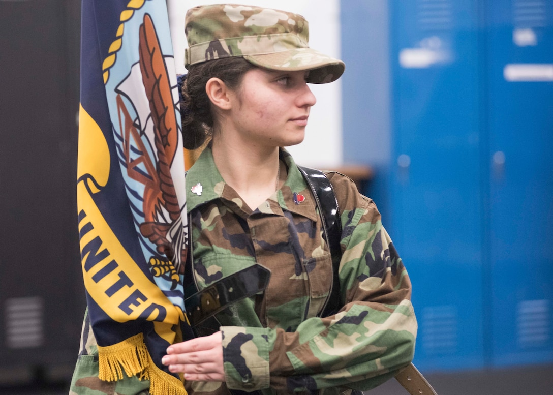 "Sherry Horner, Civil Air Patrol Spokane Composite Squadron cadet, holds a ceremonial flag while practicing ""presenting colors"" with Honor Guardsmen at Fairchild Air Force Base, Washington, Nov. 26, 2018. CAP cadets are volunteers from ages 12-20 that dedicate their time performing duties similar to the National Guard during after-school and summer camp-style programs. (U.S. Air Force photo/ Senior Airman Ryan Lackey)"