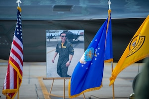"A picture of Capt. Stephen ""Trip"" Grace is displayed during a memorial service Dec. 7, 2018, at Luke Air Force Base, Ariz. Capt. Grace was assigned to the 61st Fighter Squadron and was recognized as the Company Grade Officer of the Year in 2018. (U.S. Air Force photo by Senior Airman Alexander Cook)"