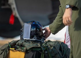 "A fighter pilot touches Capt. Stephen ""Trip"" Grace's F-35 helmet during his memorial service Dec. 7, 2018, at Luke Air Force Base, Ariz. Numerous family members and friends were in attendance to honor and celebrate the life of Capt. Grace. (U.S. Air Force photo by Senior Airman Alexander Cook)"